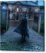 Man In Top Hat And Cape On Cobblestone Street Canvas Print