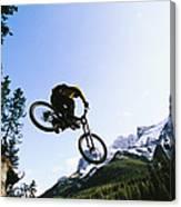 Man Jumping On His Mountain Bike Canvas Print
