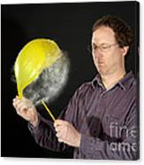 Man Popping A Balloon Canvas Print