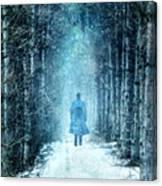 Man Walking Through Snowy Woods Canvas Print