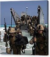 Marines Disembark A Landing Craft Canvas Print