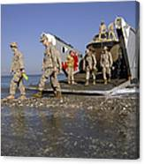 Marines Disembark From A Landing Craft Canvas Print