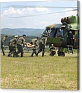 Medical Personnel Carry A Wounded Canvas Print