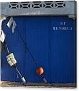 menorca st - A warehouse door in Es Castell Menorca ready to keep local tradicional boats llauts Canvas Print