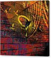 Metal Sculpture Against A Brick Wall Canvas Print