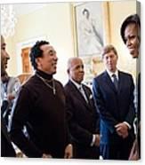 Michelle Obama Greets John Legend Canvas Print