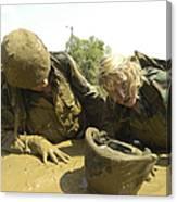Midshipmen Maneuver Through A Mud Pit Canvas Print