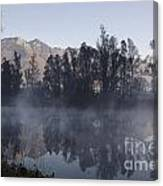 Mountain And Trees Reflected In A Foggy Lake Canvas Print