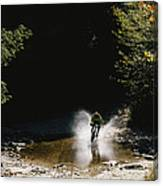 Mountain Biker Splashing Through Water Canvas Print