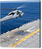 N Mh-60s Sea Hawk Helicopter Lifts Canvas Print