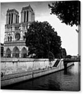 Notre Dame Along The Seine Canvas Print