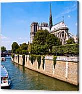 Notre Dame Cathedral Along The Seine River Canvas Print