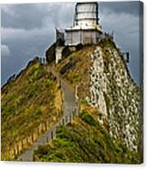 Nugget Point Light House And Dark Clouds In The Sky Canvas Print