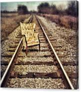 Old Chair On Railroad Tracks Canvas Print