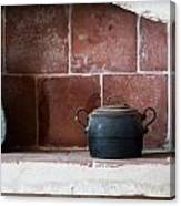 old kitchen - A part of a traditional kitchen with a vintage metal pot  Canvas Print