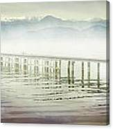 Old Wooden Bridge Into A Mountain Lake On A Foggy Morning Canvas Print