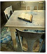Open Book On Old Table Canvas Print