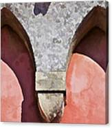 Ornate Design Of Carved Stone Arch Against A Red Faded Plaster Wall Canvas Print