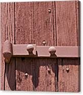 Painted Red Iron Hinge On A Red Barn Door Canvas Print