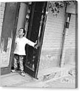 Peeking Out From Door Canvas Print