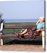 Pensioner Relaxing On A Bench Canvas Print