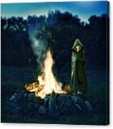 Person Standing By A Bonfire In The Moonlight Canvas Print