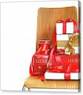 Pile Of Gifts On Wooden Chair Against White Canvas Print