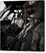 Pilot In The Cockpit Of A Uh-60l Canvas Print