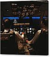 Pilots In The Cockpit Of An Aircraft Canvas Print