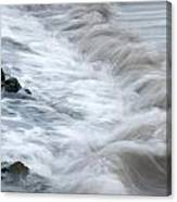 playing with waves 3 - Mediterranean sea foam playing with black stones in cala mesquida - menorca Canvas Print