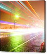 Rainy Road With Blurred Traffic At Night Canvas Print