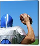 Rear View Of A Football Player Throwing A Football Canvas Print