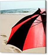 Red And Black Umbrella On The Beach With Footprints Canvas Print