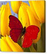 Red Butterful On Yellow Tulips Canvas Print