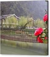 Red Flower Over Bridge Canvas Print