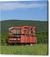 Red Hay Wagon In Green Mountain Field Canvas Print