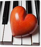Red Stone Heart On Piano Keys Canvas Print