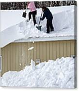 Removing Snow From A Building Canvas Print