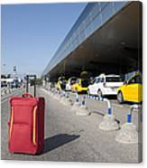 Rolling Luggage Outside An Airport Terminal Canvas Print