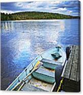Rowboat Docked On Lake Canvas Print