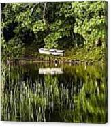 Rowboat Moored On The Bank Of A Lake Canvas Print