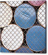 Rows Of Stacked Barrels Behind A Fence Canvas Print
