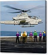 Sailors And Marines Watch An Ah-1z Canvas Print