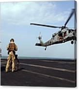 Sailors Prepare To Board An Mh-60s Sea Canvas Print