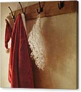 Santa Costume Hanging On Coat Rack Canvas Print
