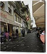 Seated In The Cafe Along The River In Lucerne In Switzerland Canvas Print