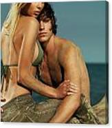 Sensual Portrait Of A Young Couple On The Beach Canvas Print