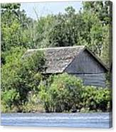 Shack On The River Canvas Print