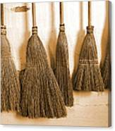 Shaker Brooms On A Wall Canvas Print
