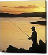 Silhouette Of A Fisherman Fishing On Canvas Print